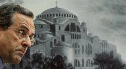 PM Samaras with a still from an election campaign video by New Democracy, where the minarets in Aghia Sofia, Istanbul, have been erased, playing to nationalist sensibilities